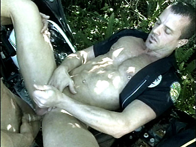 Hard muscled cop Patrick Ives stroking his shaft while taking a stiff baton in his bottom